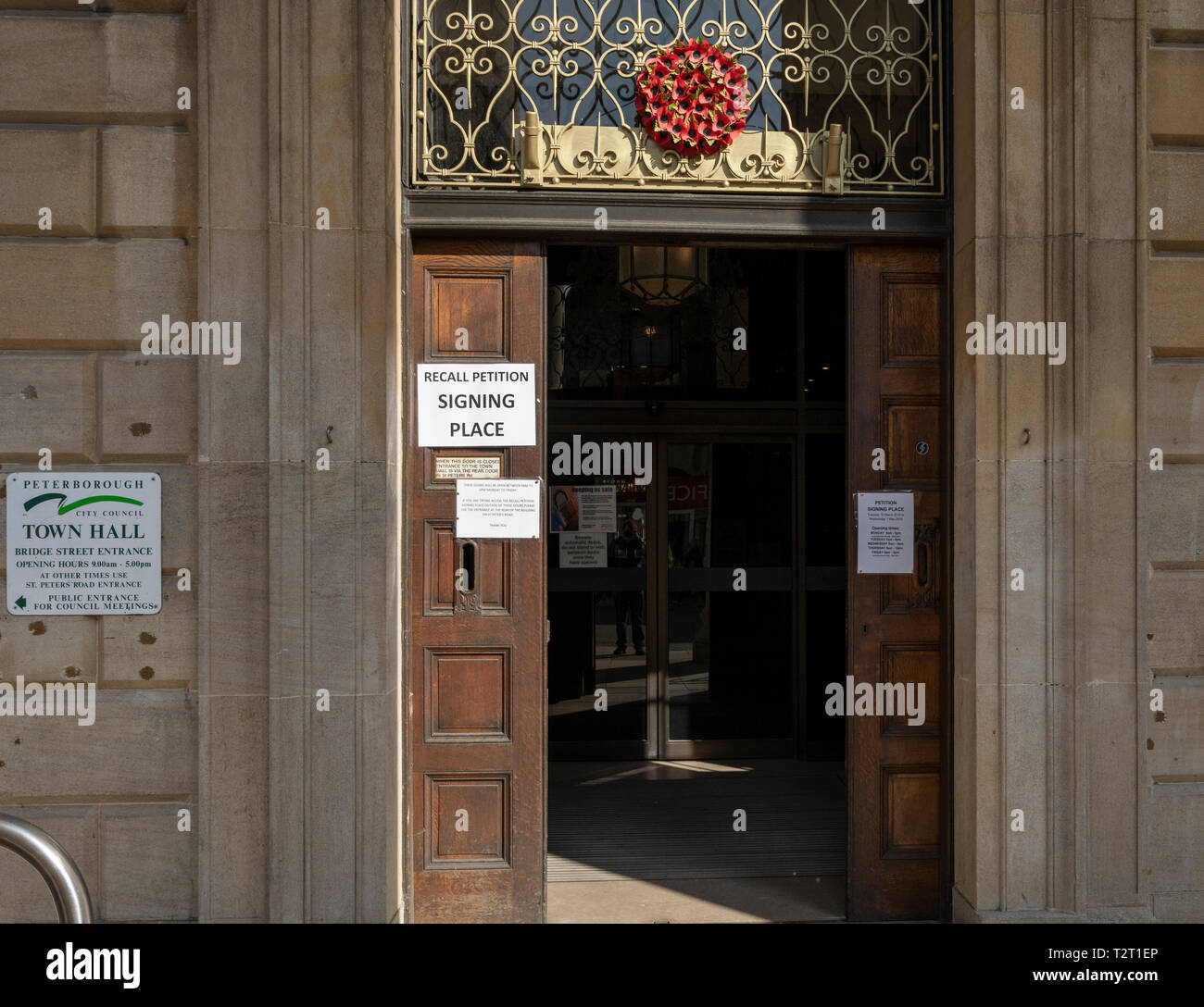The front doorway of Peterborough Town Hall with signs relating to a recall petition to force convicted local MP Fiona Onasanya out of office - Stock Image