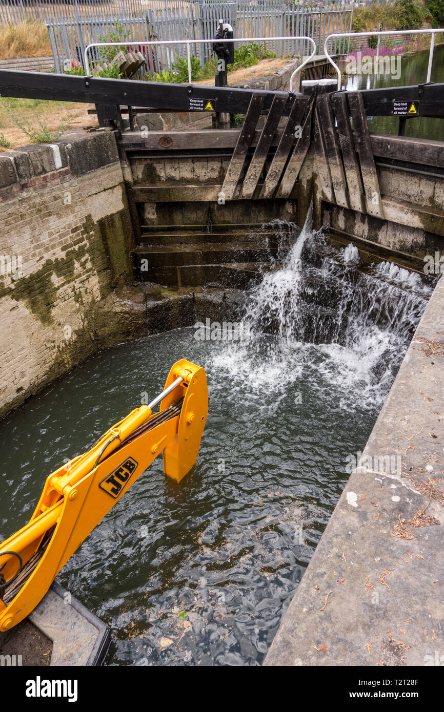 Specially adopted JCB digger in Stroudwater Navigation canal, Stroud, Gloucestershire, UK Stock Photo
