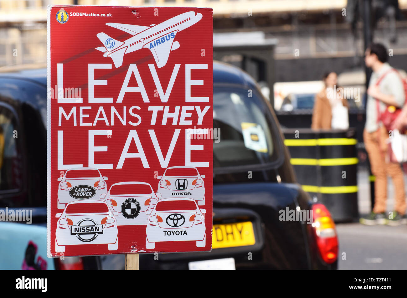Anti Brexit sign in Westminster London UK stating that if the UK leaves the EU large employers such as Air Bus, Honda, Nissan, BMW will leave the UK - Stock Image