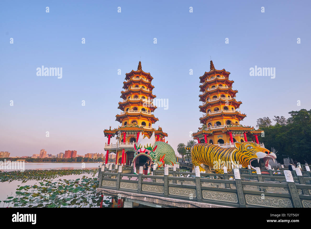 Kaohsiung, Taiwan - December 3, 2018: People come to merit at Cih Ji Dragon and Tiger Pagodas on lotus pond in sunset time at Zuoying district, Kaohsi - Stock Image