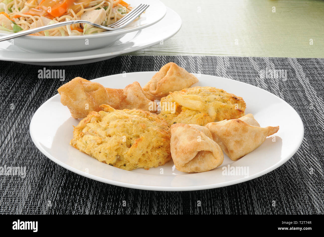 Appetizer plate of crab rangoon and crab cakes - Stock Image