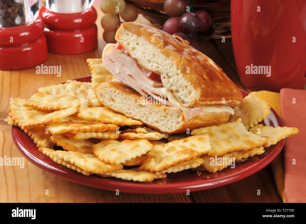 A turkey and cheese sandwich with crackers - Stock Image