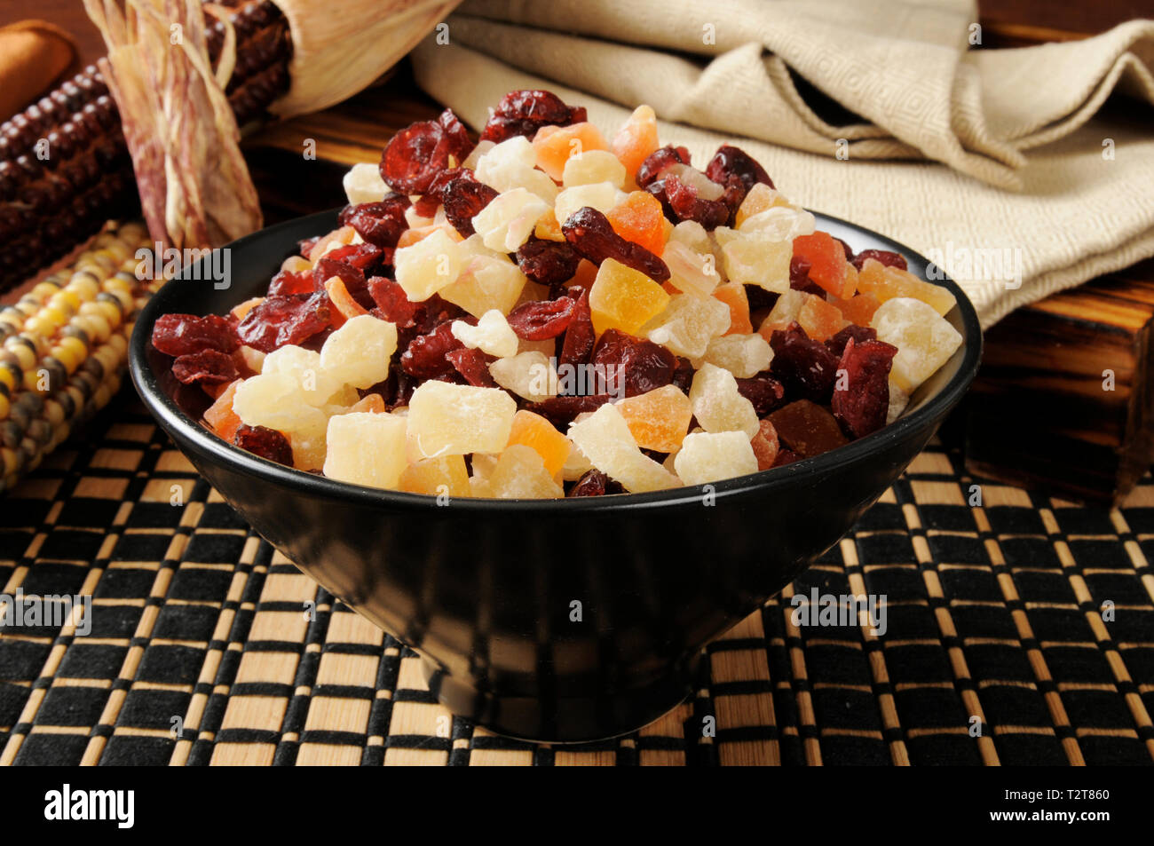 A bowl of dried tropical fruit - Stock Image