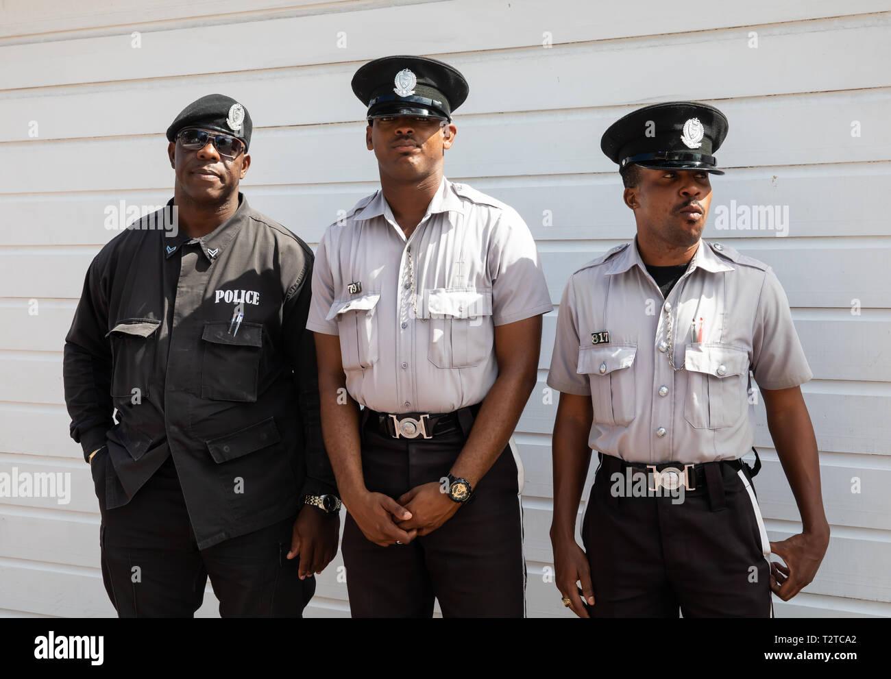 Three police officers in Saint John's, Capital of Antigua and Barbuda Stock Photo