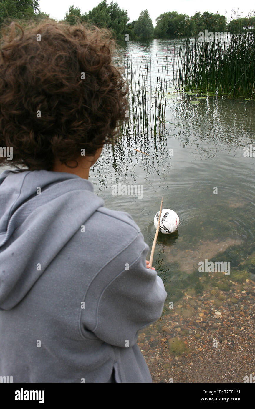 children playing near open water, risk to life Stock Photo