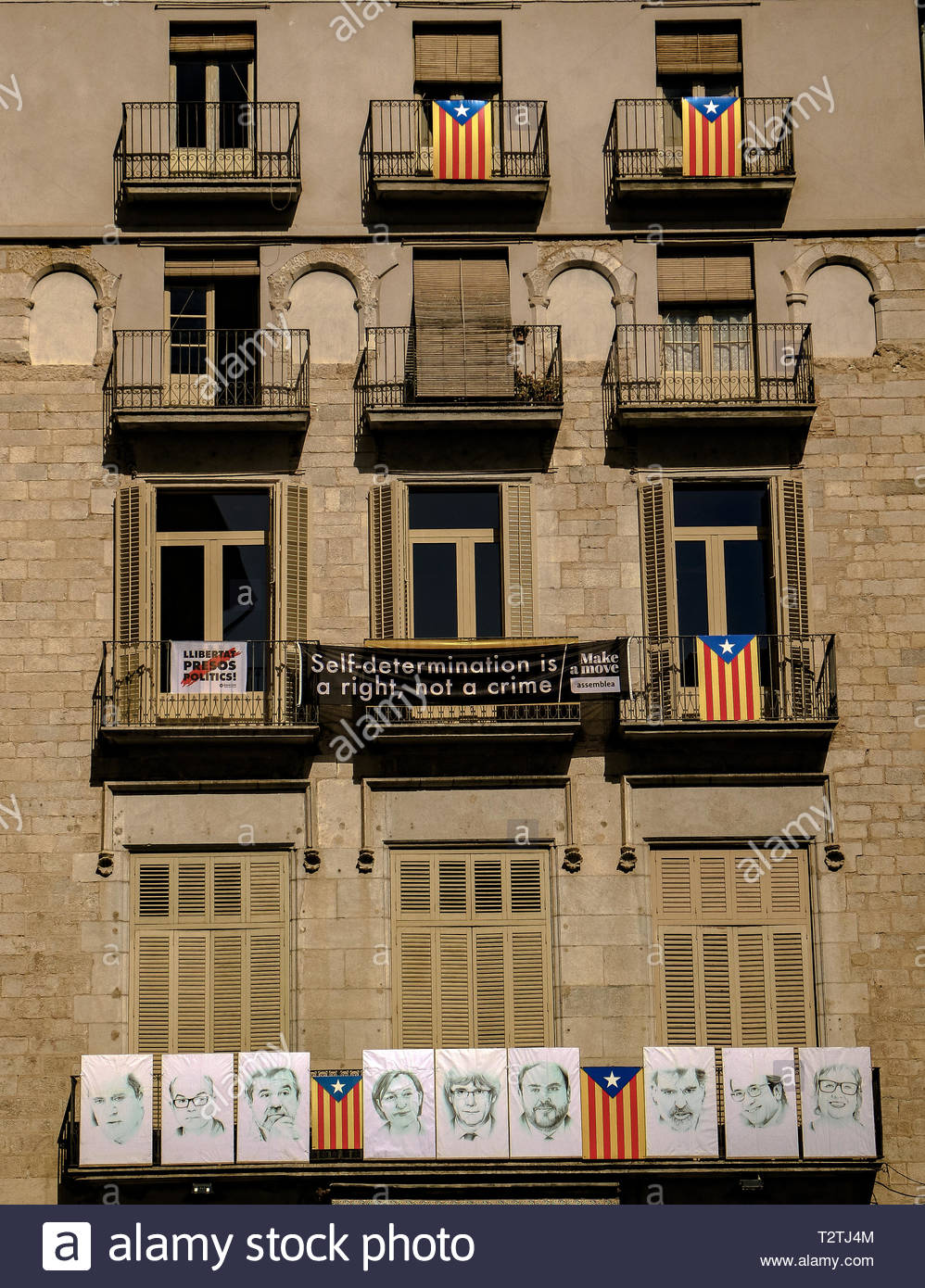 Building Façade with images of Catalan Government Officials imprisoned for voting for Independence from Spain March 2019 Stock Photo