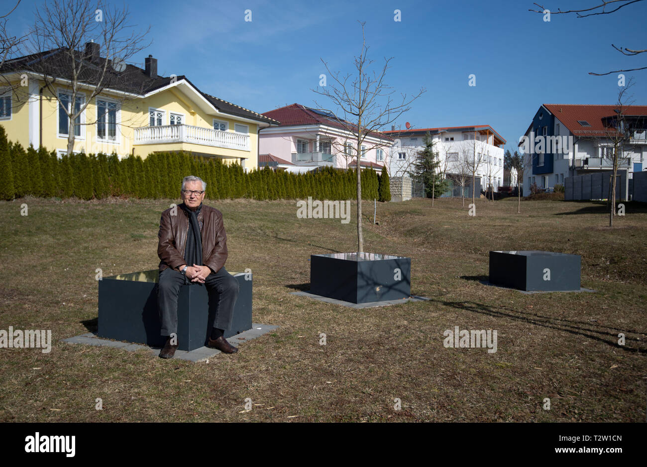 Mutlangen, Germany. 28th Feb, 2019. Peter Seyfried, former mayor of Mutlangen, sits on an object of an installation by the artist Klaudia Dietewich in the Mutlanger Heide residential area. Before being converted into a residential area, the site served as a missile base on which US medium-range nuclear missiles of the Pershing II type were stationed. (to dpa: 'No, no, Njet' - The Eastern Alb sends peace signals again) Credit: Marijan Murat/dpa/Alamy Live News - Stock Image