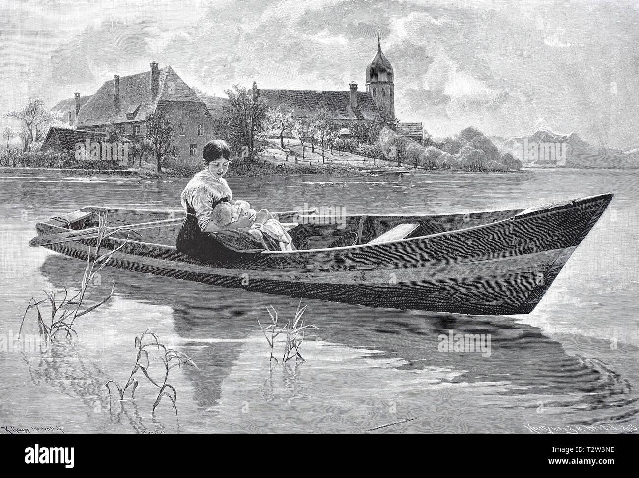 Peaceful mood in Lake Chiem, in a small boat sits a woman in the holiday dress and holds her baby in the arm, Friedliche Stimmung am Chiemsee, In einem Kahn sitzt eine Frau im Feiertagskleid und hält ihr Baby im Arm - Stock Image