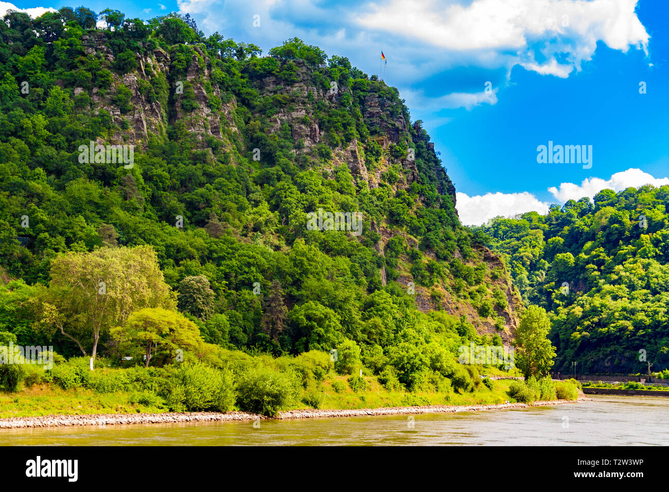 Fantastic landscape view of the steep Lorelei (Loreley in German) Rock on the riverbank of the River Rhine in the Rhine Gorge at Sankt Goarshausen in... Stock Photo