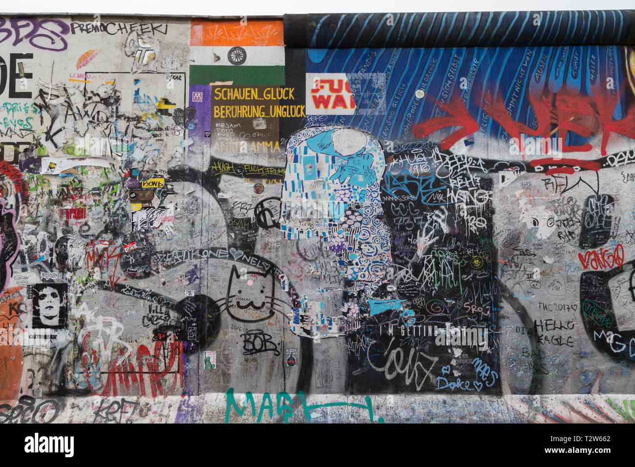 Front view of murals, graffiti, tags and writings at the East Side Gallery, section of the Berlin Wall in Berlin, Germany. Stock Photo
