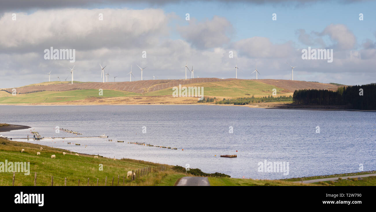 Llyn Brenig reservoir with the Clocaenog wind farm on the Denbigh moors North Wales it is a popular area for cycling fishing and hiking - Stock Image