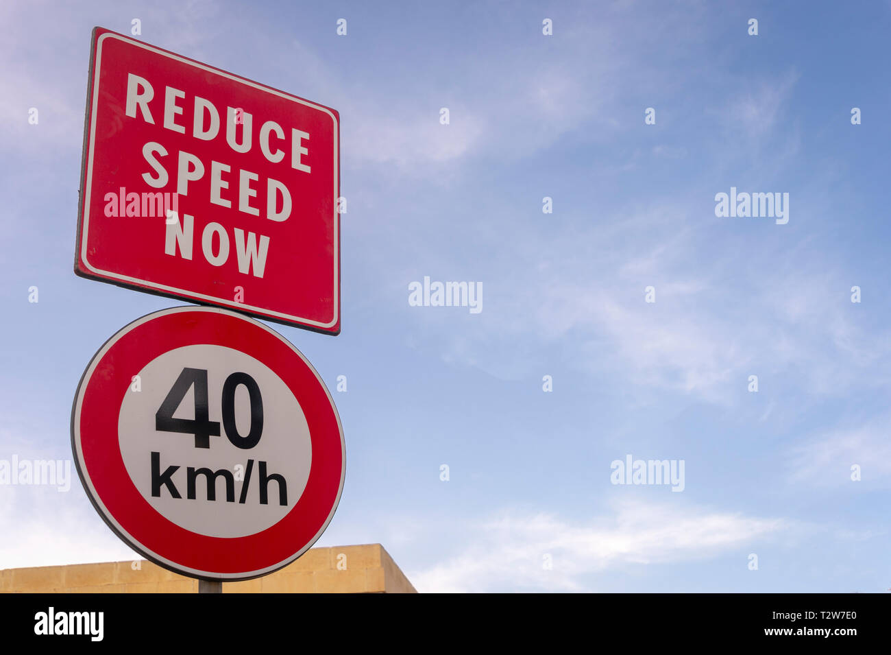 Reduce speed now, 40 KMH, road sign Stock Photo