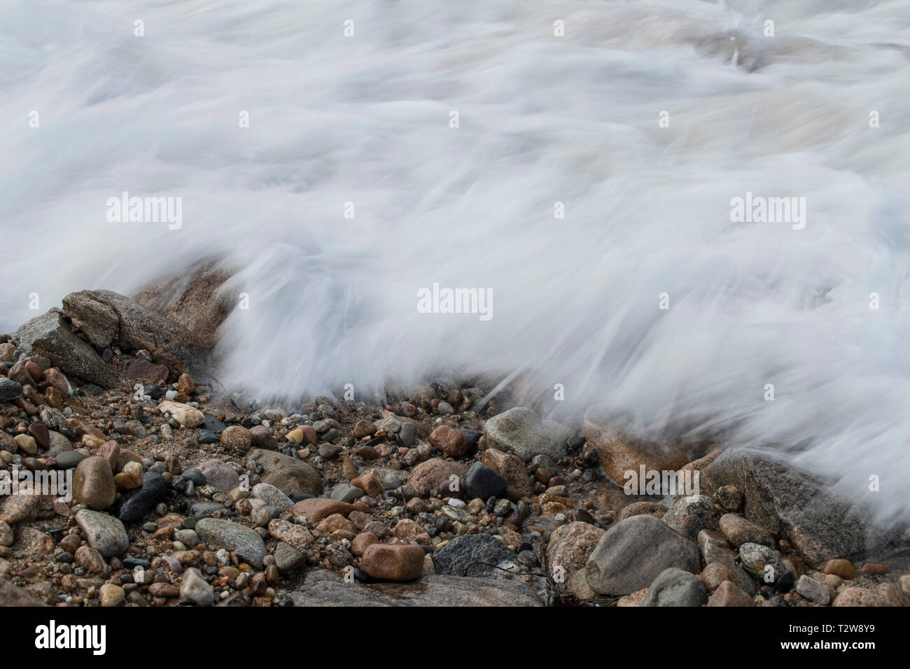 slow shutter waves at Old Harbor Beach, Block Island, RI. Rocky shoreline at Old Harbor Beach, Block Island, Rhode Island, USA. Vacation resort mostly. - Stock Image