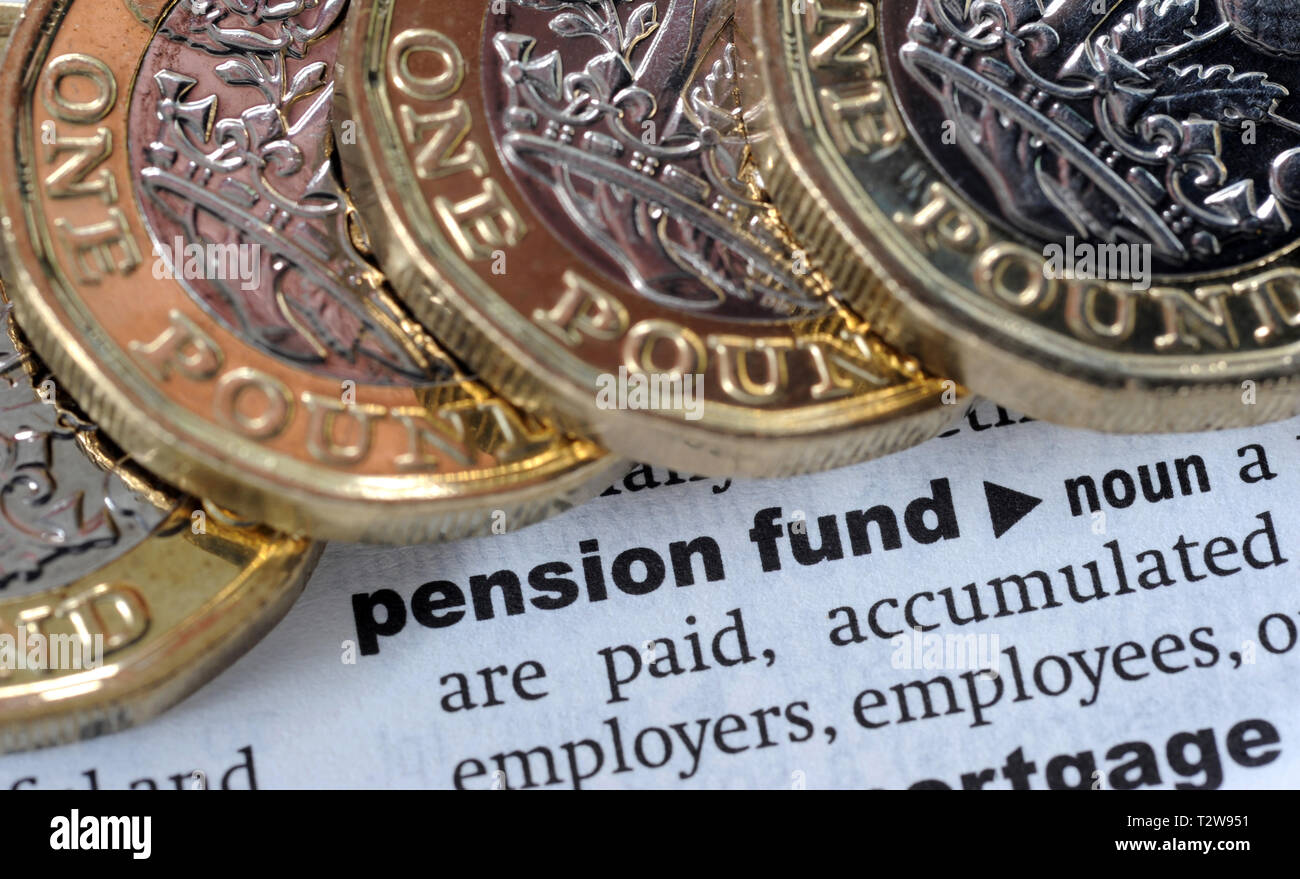 DICTIONARY DEFINITION OF PENSION FUND WITH ONE POUND COINS RE PENSIONS TAX HMRC ETC UK - Stock Image