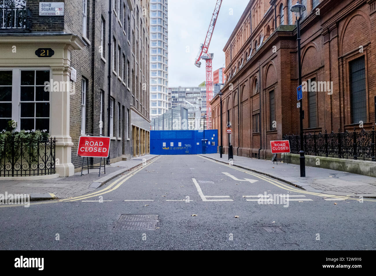 76b107abec8 Road closed due to construction works in Soho London - Stock Image
