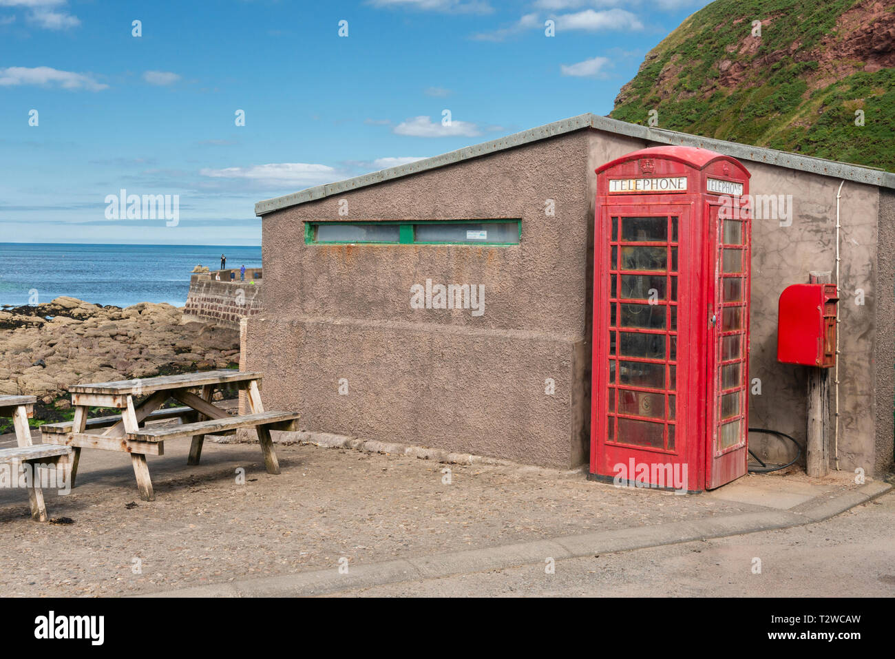 Red Telephone Box / Telephone Kiosk / Call Box In Pennan on the Aberdeenshire Coast in North East Scotland - Stock Image