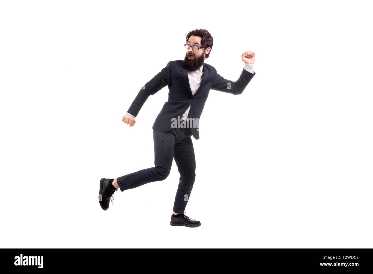Full length portrait of a run away bearded businessman, isolated on white background Stock Photo