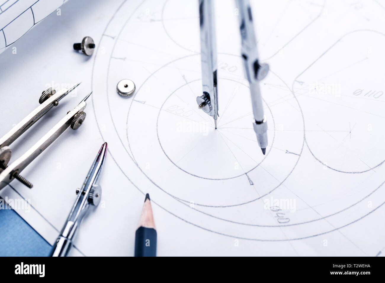 Compass on the details of the industrial drawing. compasses and blueprint. selective focus Stock Photo