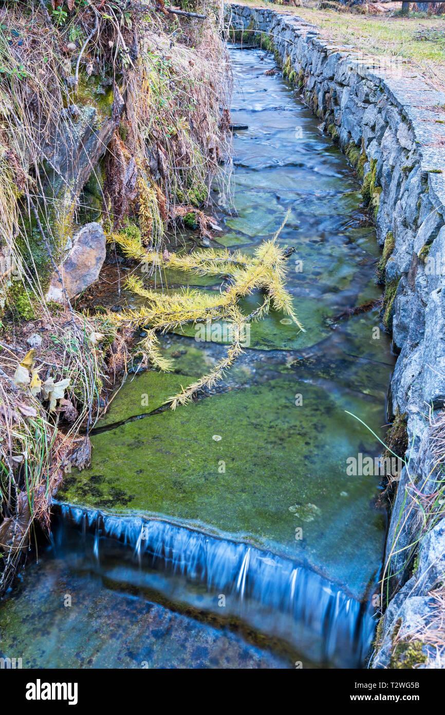Italy, Aosta Valley, Rhemes Valley, Pellaud alpine lake, Grand Ru irrigation ditch Stock Photo