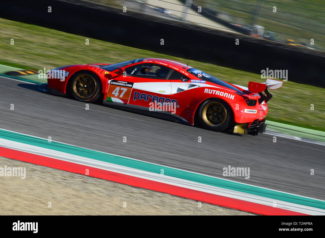 Italy - 29 March, 2019: Ferrari 488 GT3 of Rinaldi Racing Team driven by Andrea Montermini/Andrea Fontana/Wolfgang Triller in action at 12h Hankook. Stock Photo