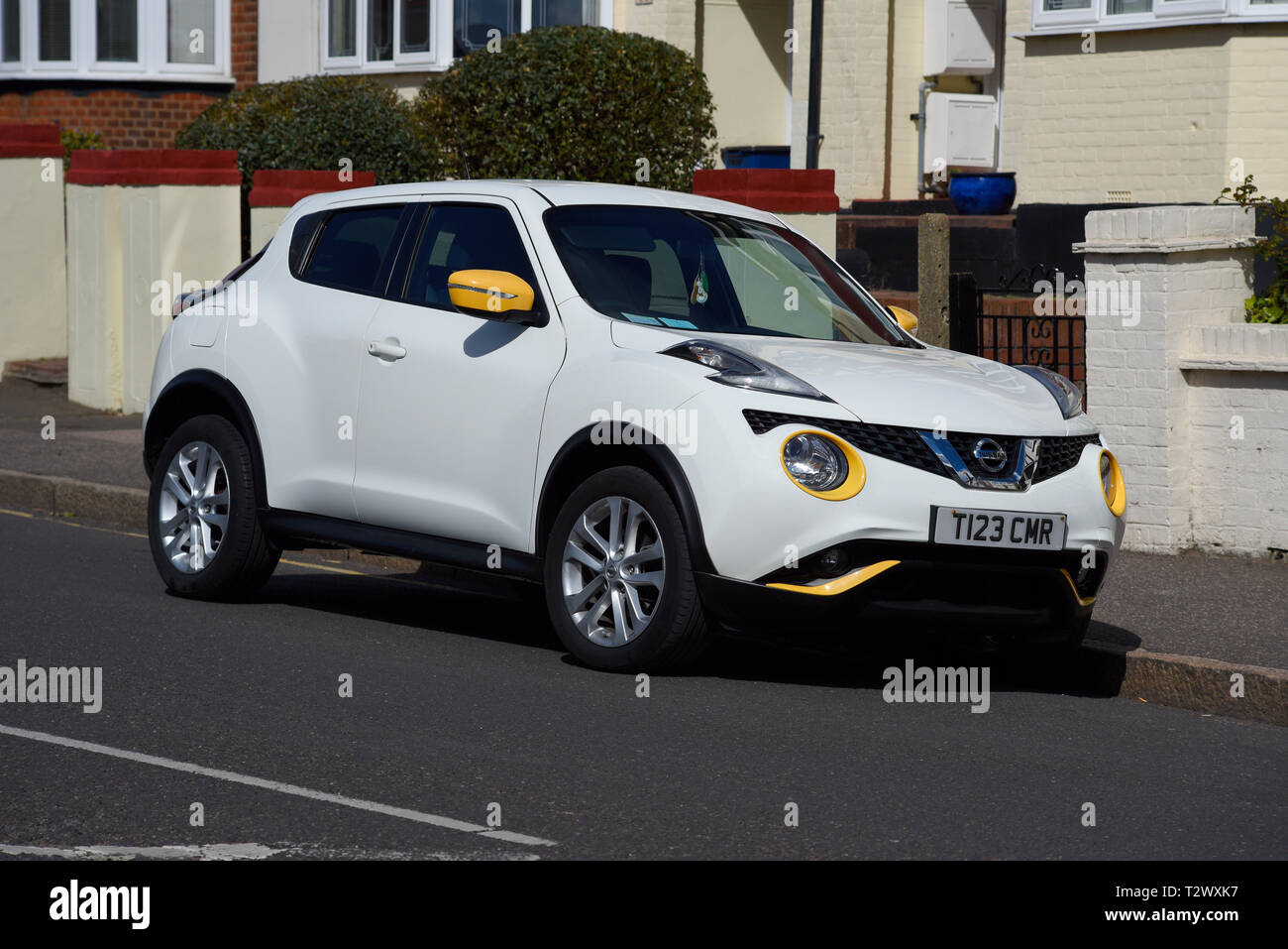 nissan juke high resolution stock photography and images alamy https www alamy com white nissan juke with yellow optional detailing parked in a residential street personalised special number plate suv crossover built in uk nmuk image242744187 html
