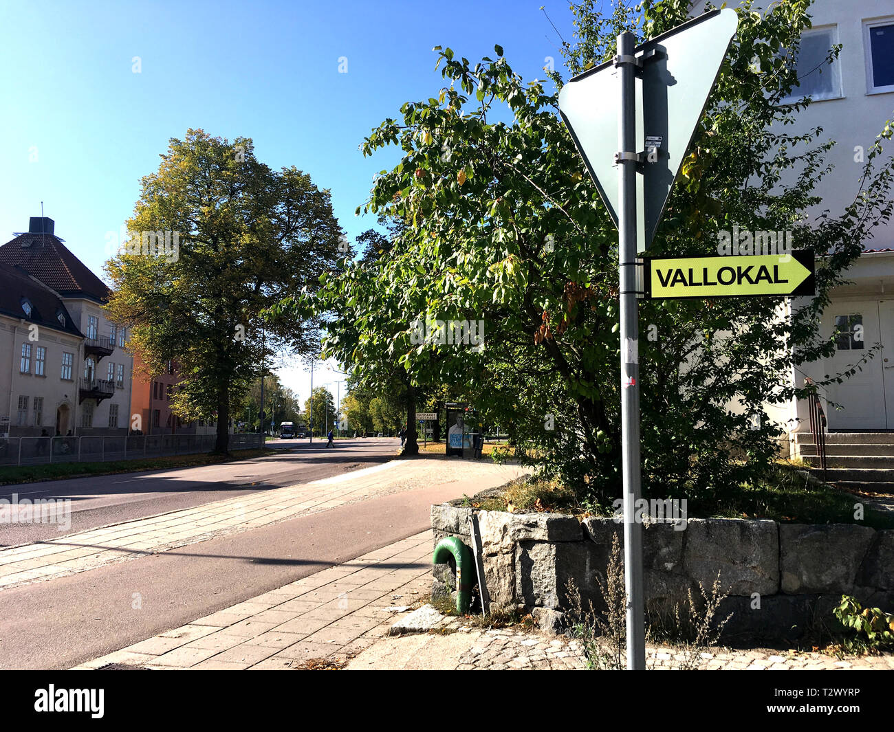 Polling station street sign in Swedish, showing the direction to a polling station in the neigborhood on election day in Sweden. - Stock Image