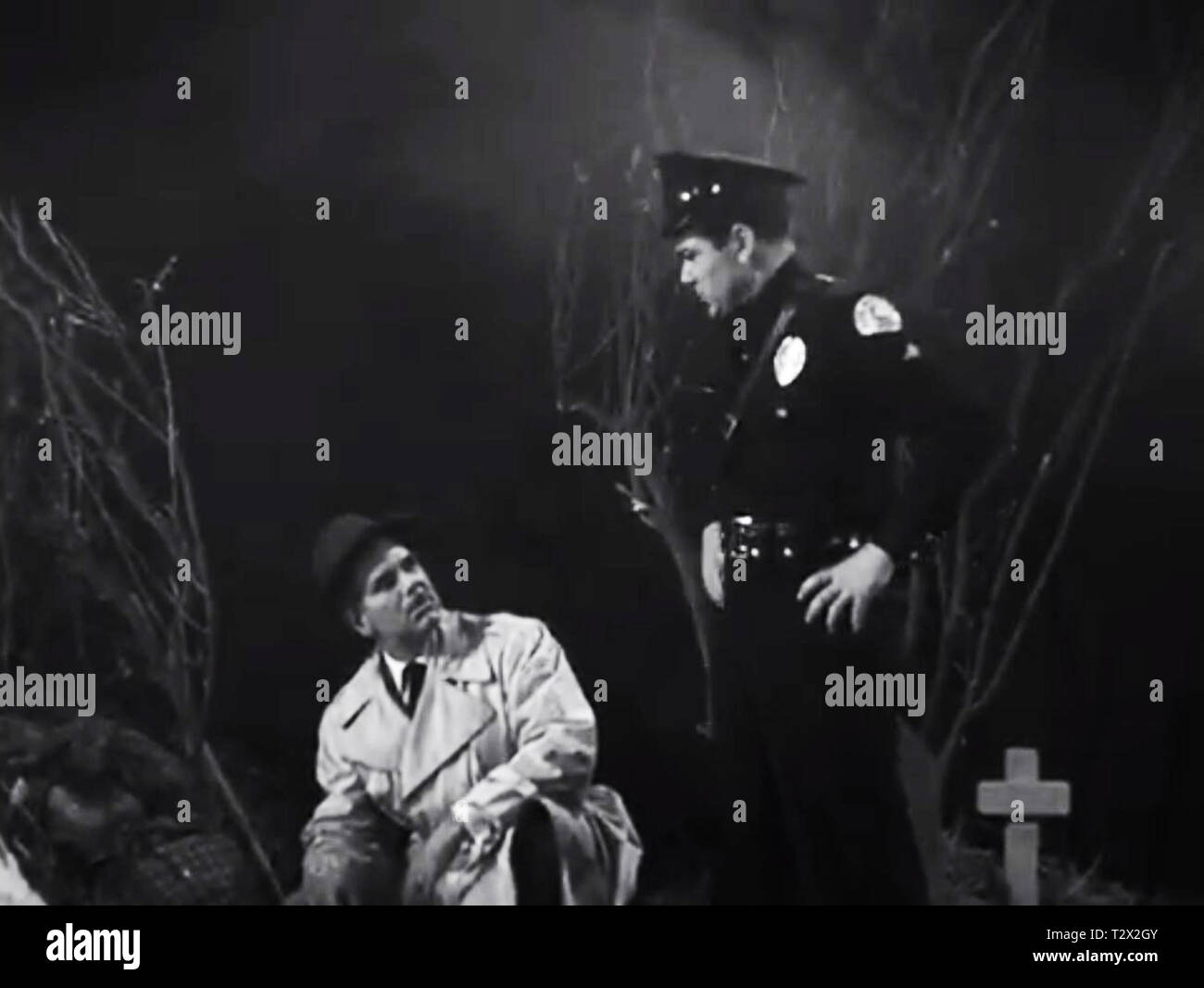 cops searching in an old black and white films (plan 9 from outer space) - Stock Image
