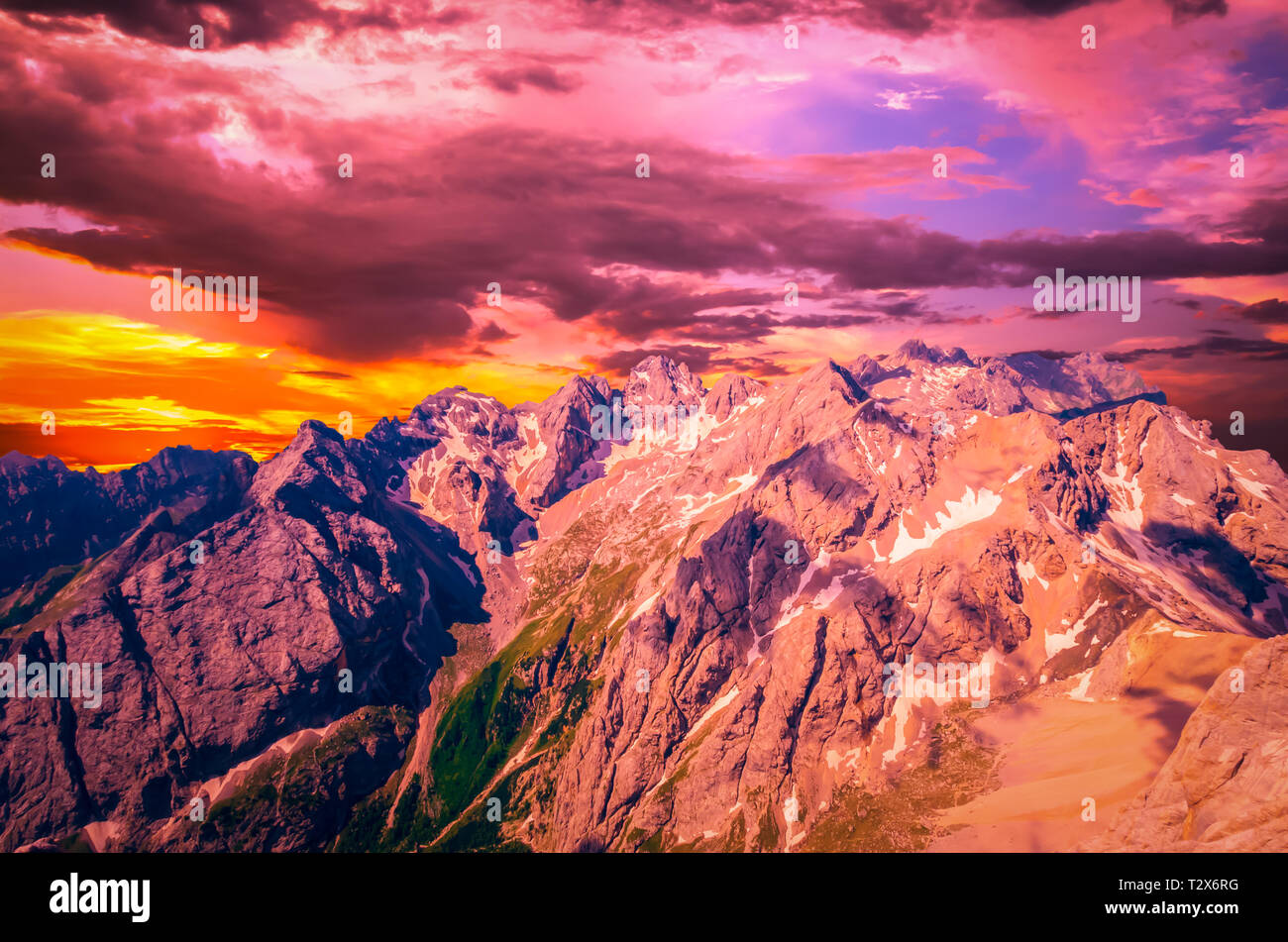 Stunning sunset over Marmolada massif, Dolomiti, Itay. Spectacular view over the Punta Rocca and other peaks in Dolomites mountains - Stock Image