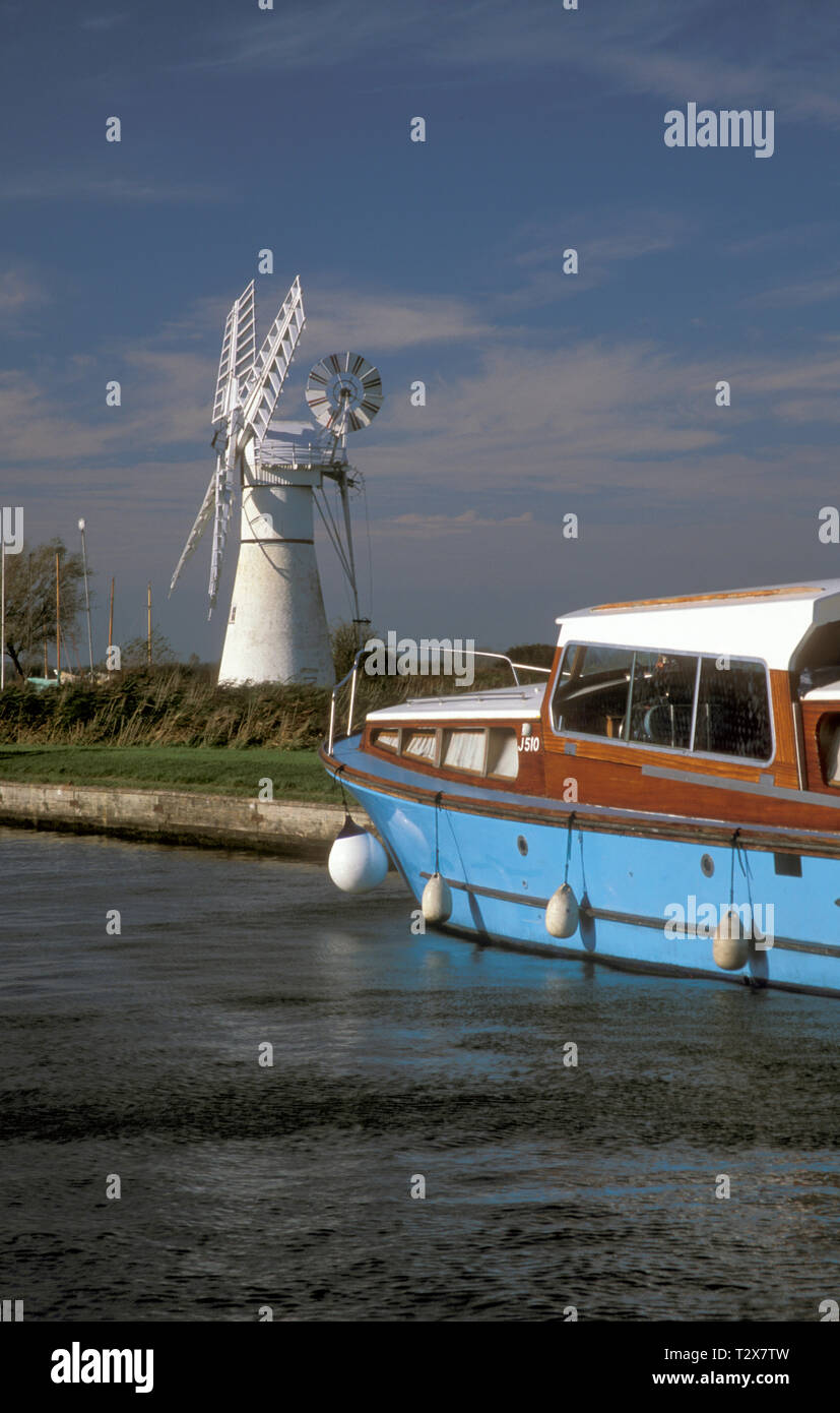 Morse's Mill and old boat in Thurne Dyke, Norfolk, England Stock Photo
