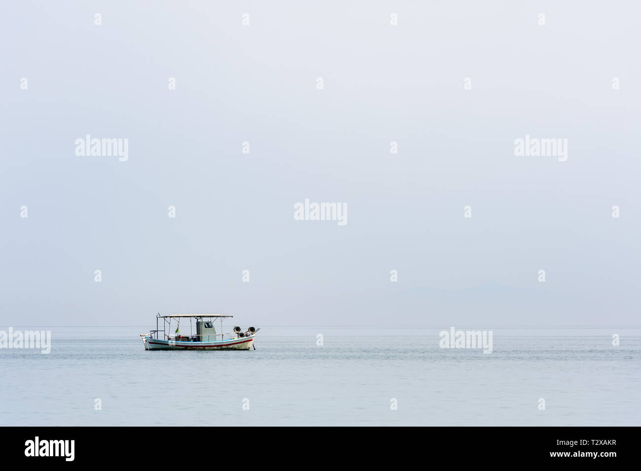 Two small fishing boat at sea surface - Stock Image