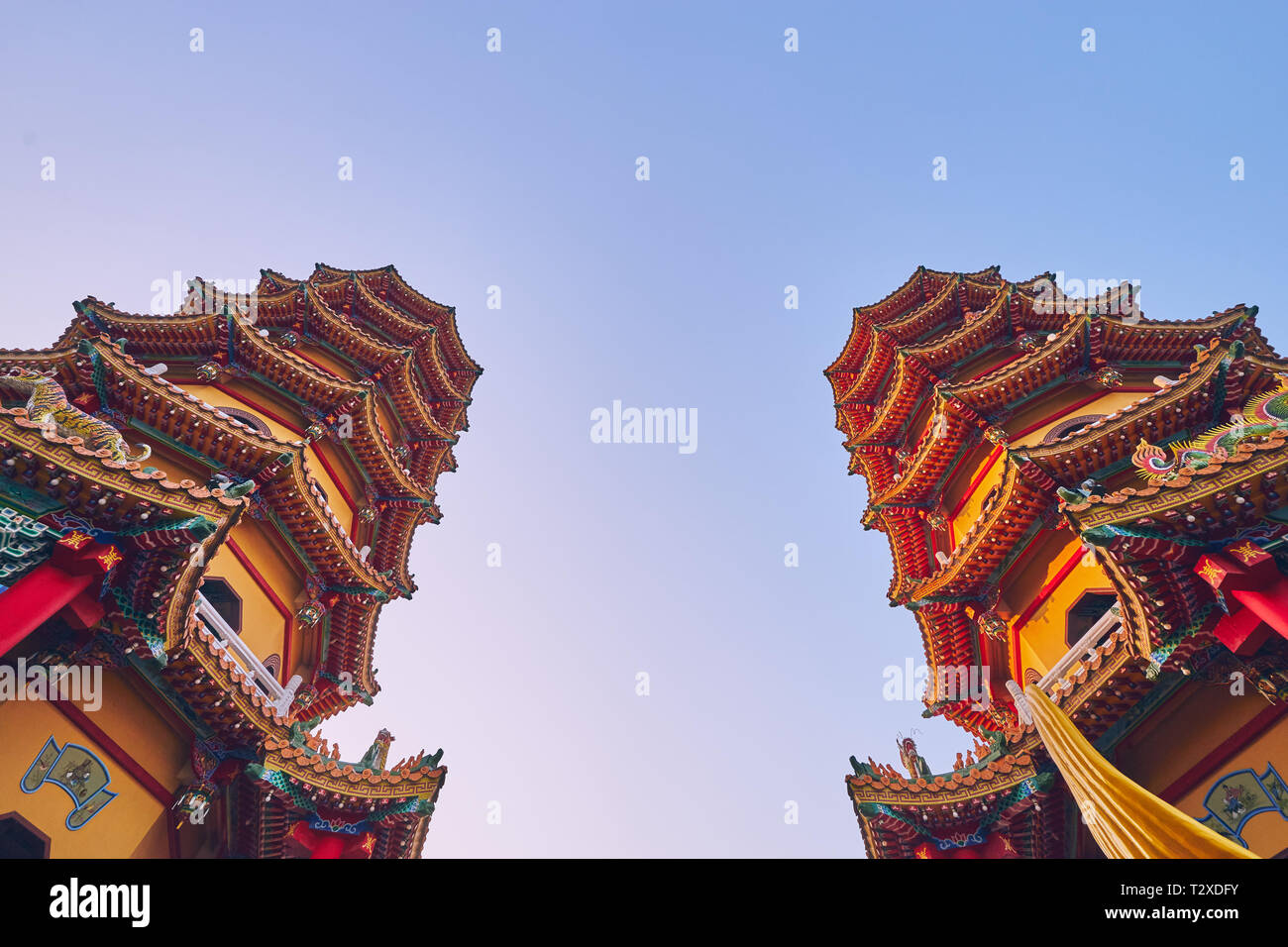 Kaohsiung, Taiwan - December 3, 2018: The Two tower of Cih Ji Dragon and Tiger Pagodas on lotus pond in sunset time at Zuoying district, Kaohsiung cit - Stock Image