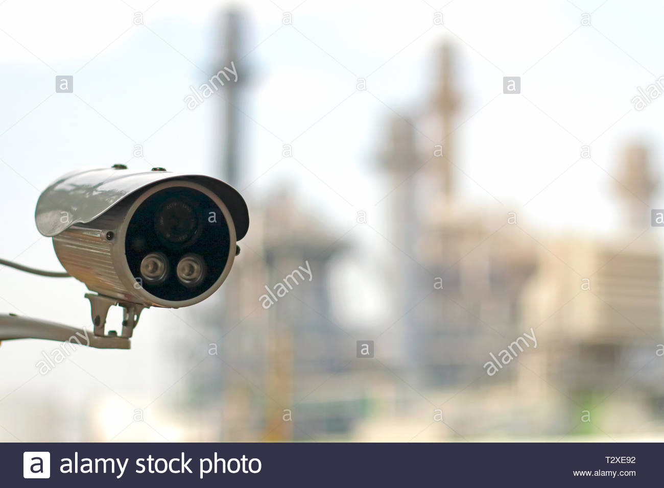 CCTV camera (closed circuit camera) surveillance Safety system with power plant on background - Stock Image