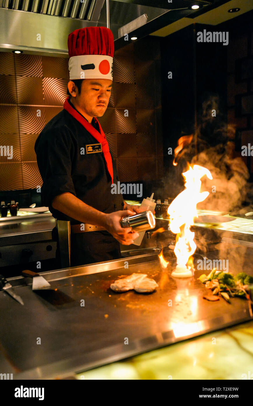 Japanese Chef cooking with fire on a grill at a Japanese steak house restaurant. Stock Photo
