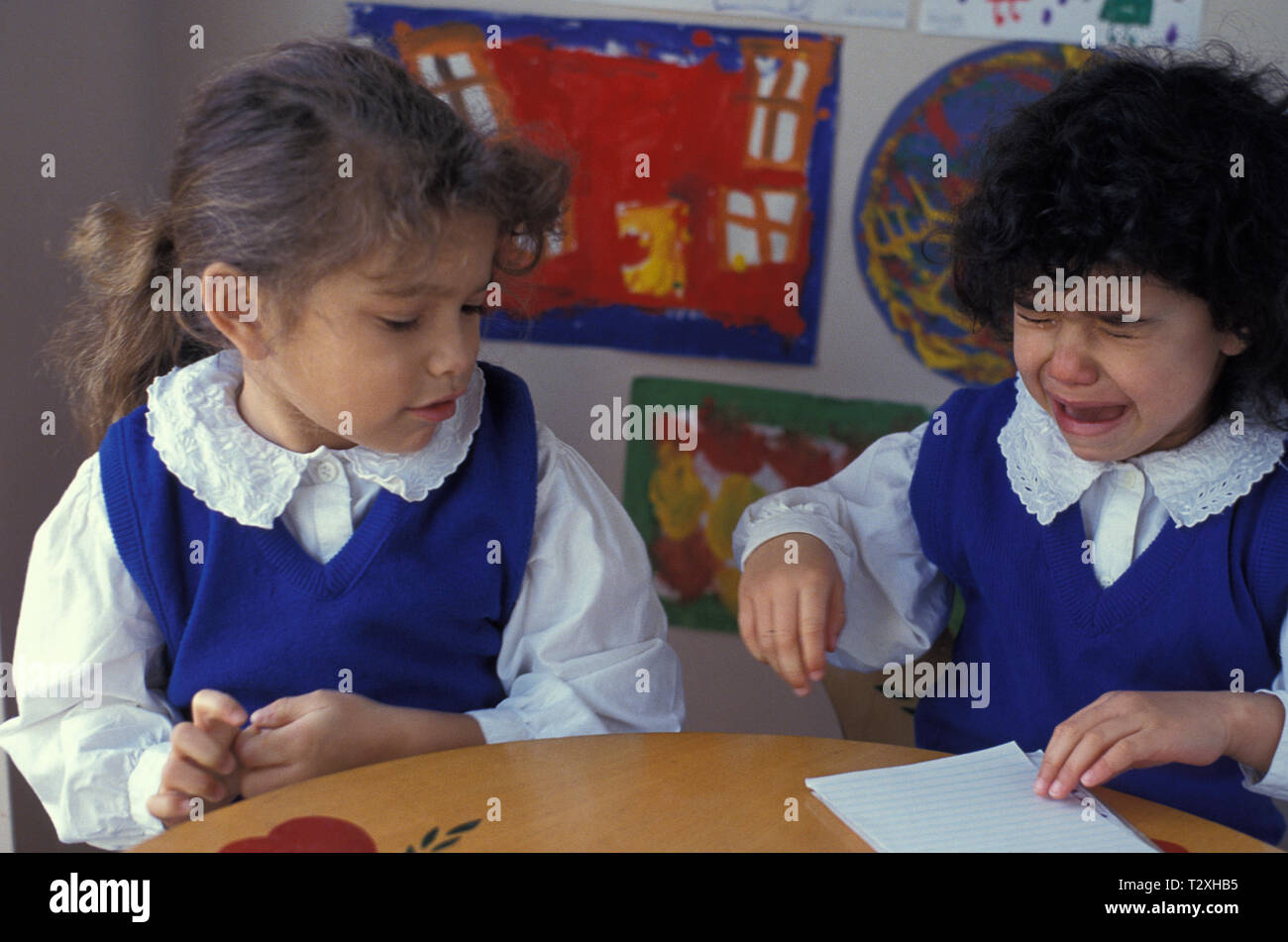 two primary school girls fighting Stock Photo