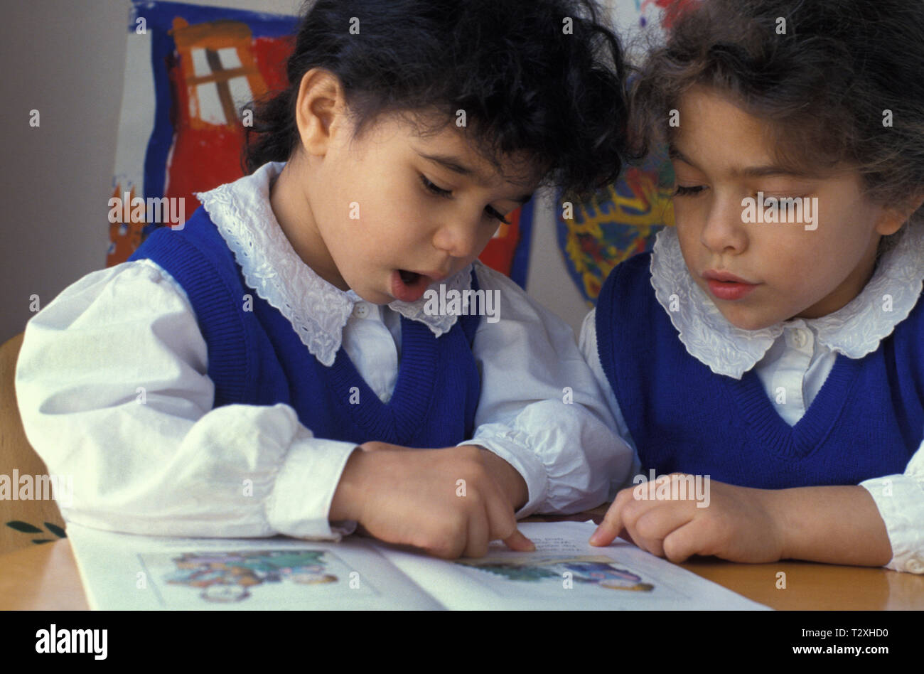 two little girls reading out loud in class Stock Photo