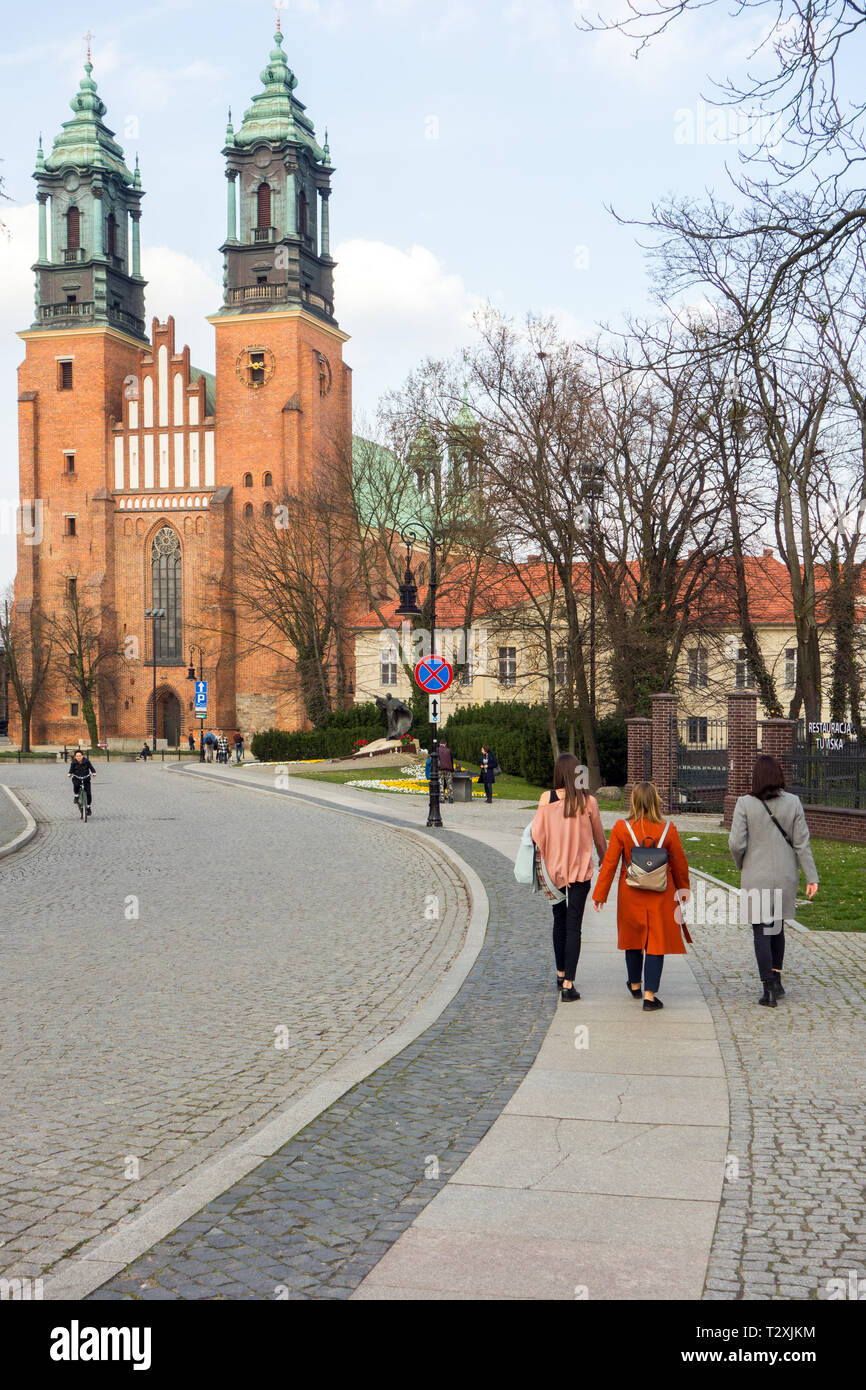 Tourists and visitors at Poznan basilica / cathedral standing on Ostrow Tumski Island,the oldest Cathedral in Poland dating from the 10th century Stock Photo