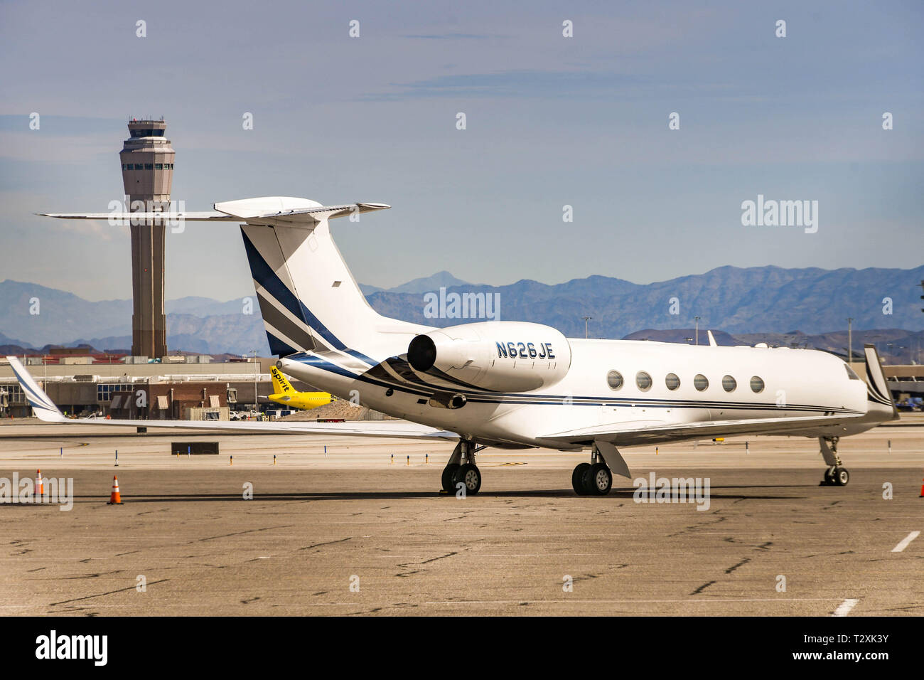 LAS VEGAS, NEVADA, USA - FEBRUARY 2019: Gulfstream V private executive jet parked at McCarran International Airport in Las Vegas. In the background is - Stock Image
