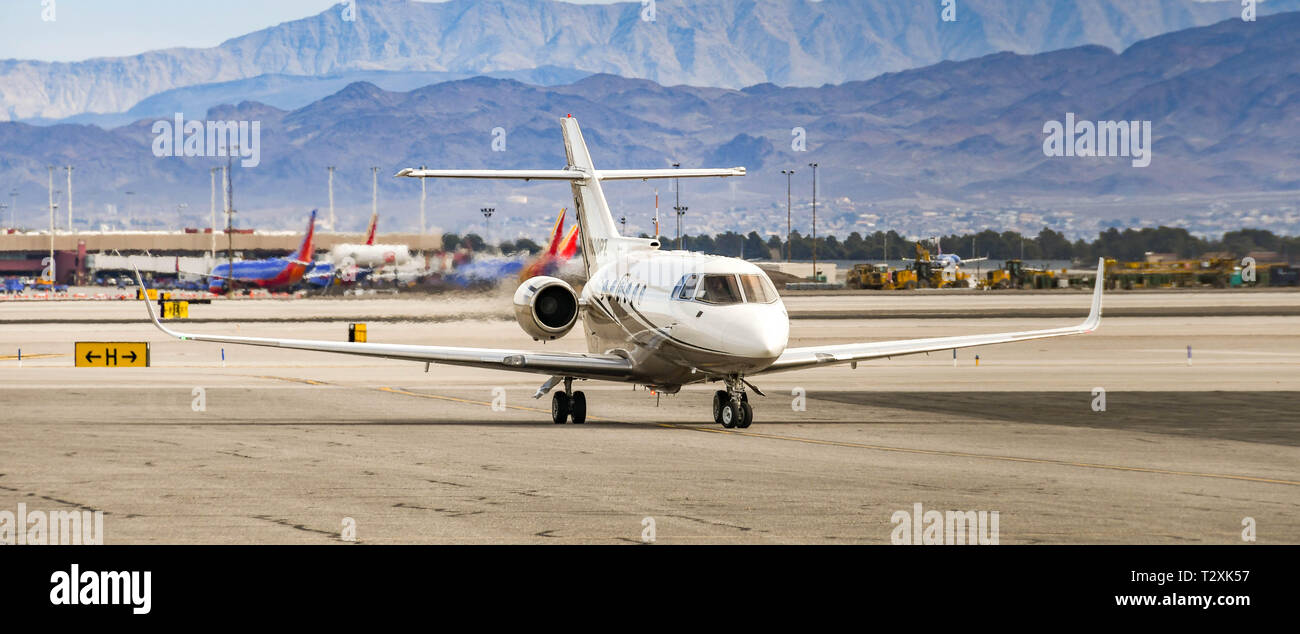 LAS VEGAS, NEVADA, USA - FEBRUARY 2019: Hawker 800 private executive jet taxiing after landing at McCarran International Airport in Las Vegas. - Stock Image