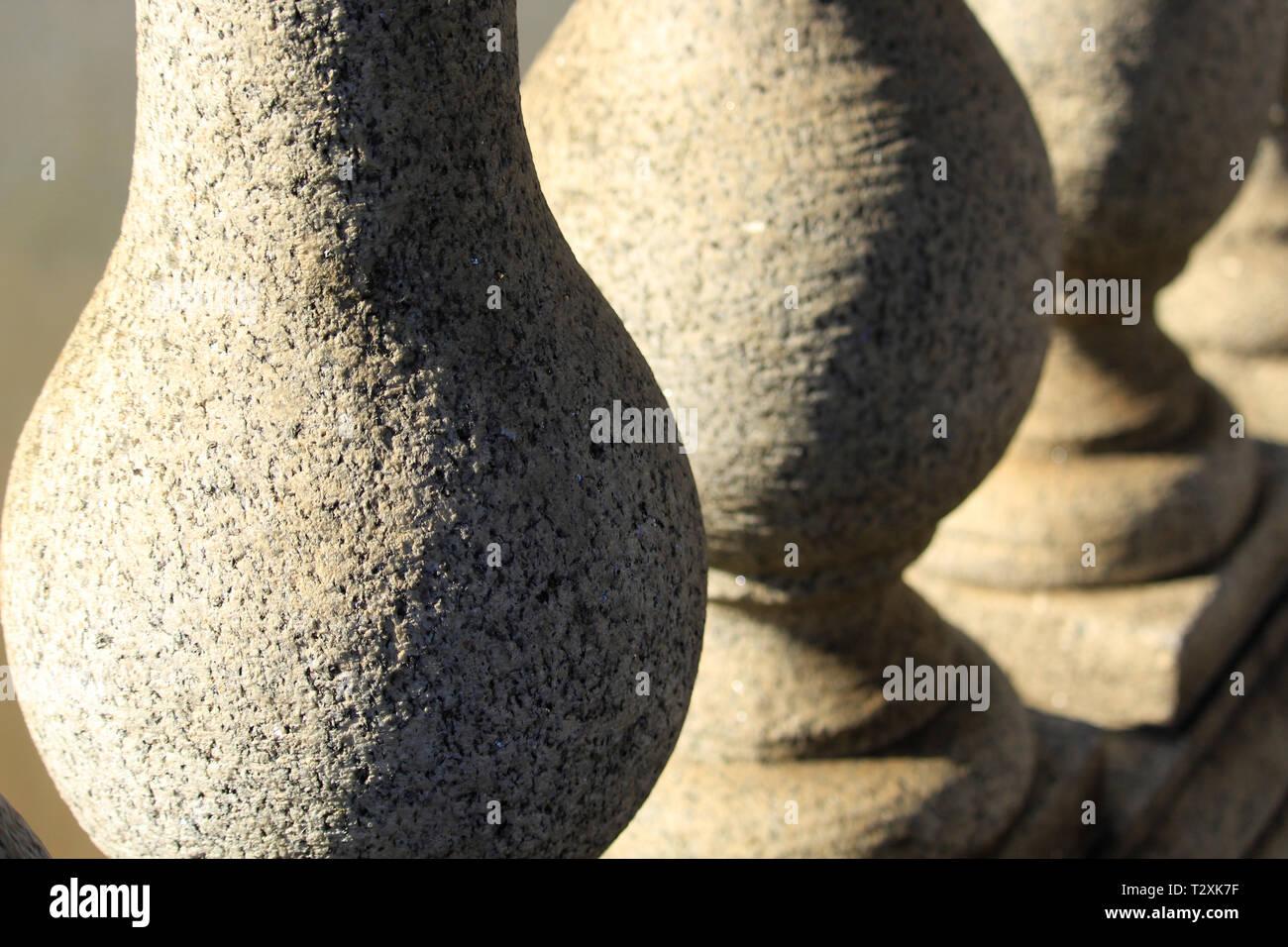 Round stone pillars along a bridge - Stock Image