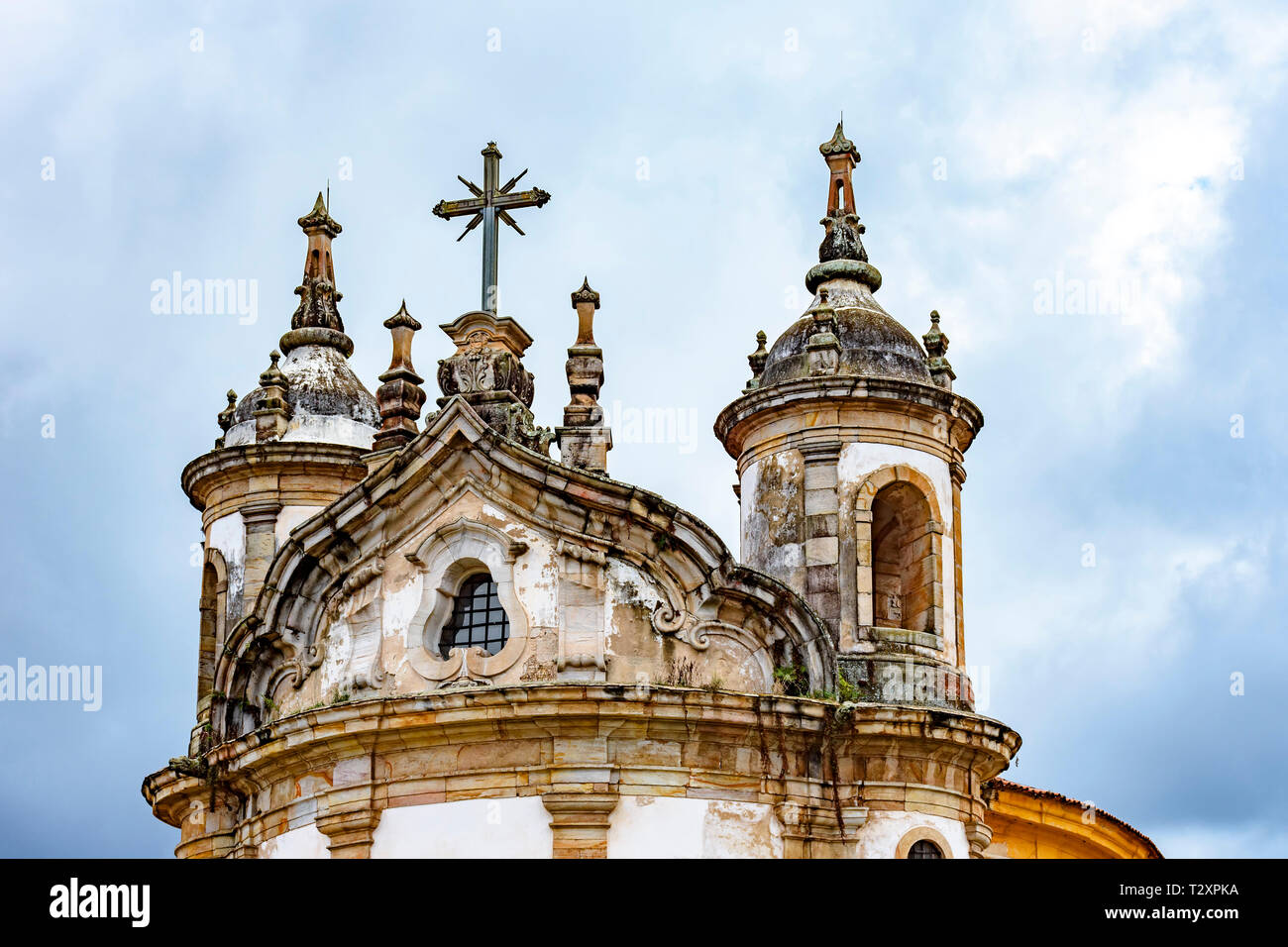 Old catholic church tower with ornaments of the 18th century located in the center of the famous and historical city of Ouro Preto in Minas Gerais - Stock Image
