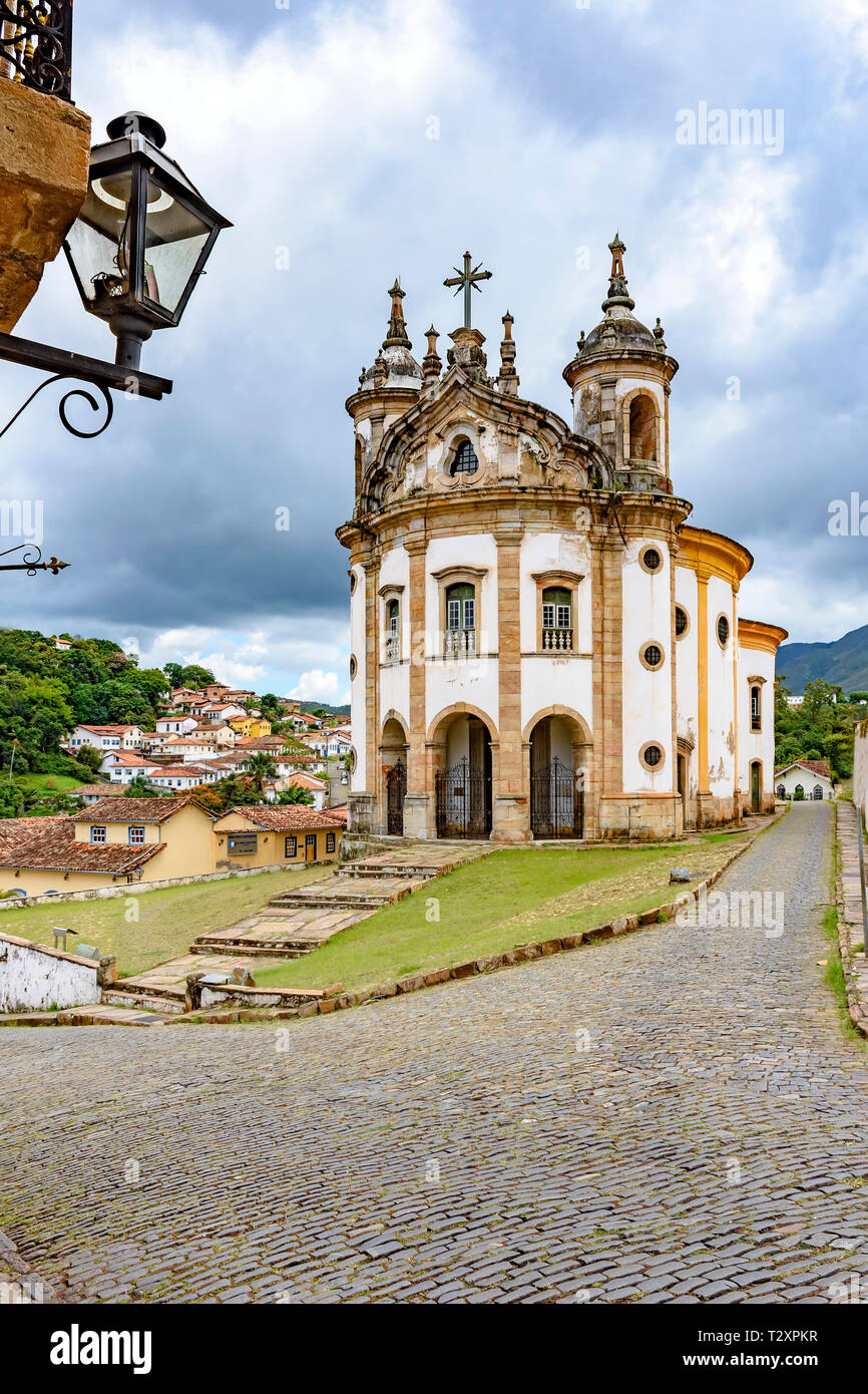Old catholic church of the 18th century and constructions around located in the center of the famous and historical city of Ouro Preto in Minas Gerais - Stock Image