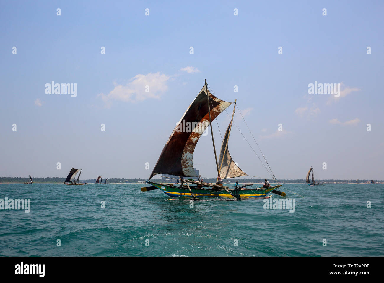 Sri Lankan traditional fishing catamarans in Laccadive Sea at Negombo, Sri Lanka Stock Photo