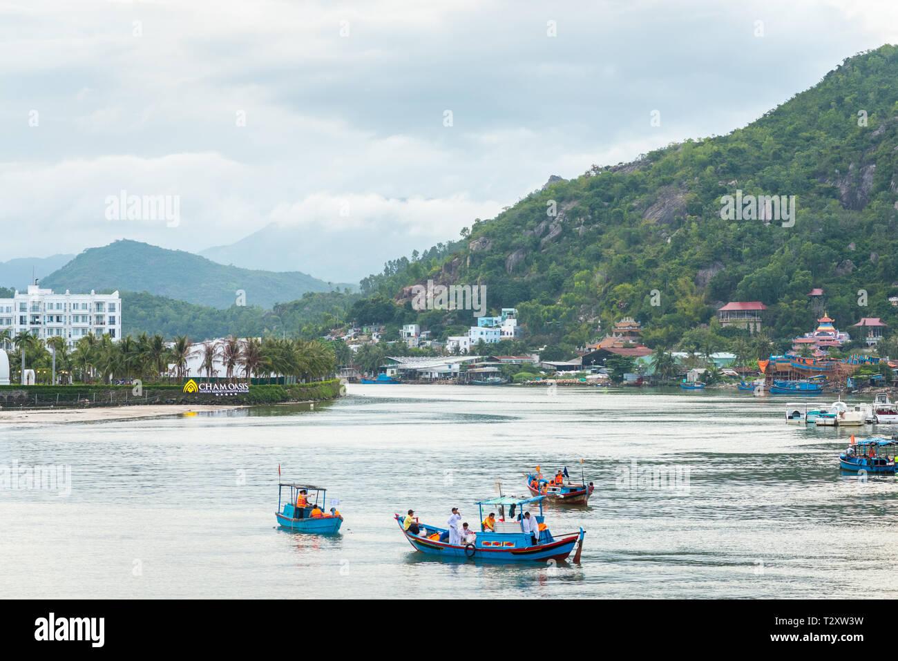 Nha Trang, Vietnam - May 5, 2018: Cai River with fishermen' blue boats. Stock Photo