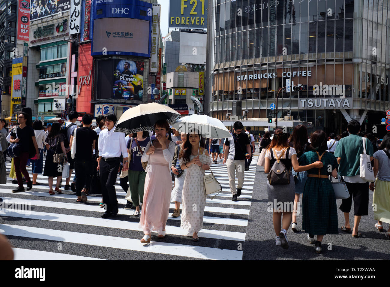 Pictures are pedestrians crossing Shibuya Crossing Tokyo Japan - Stock Image