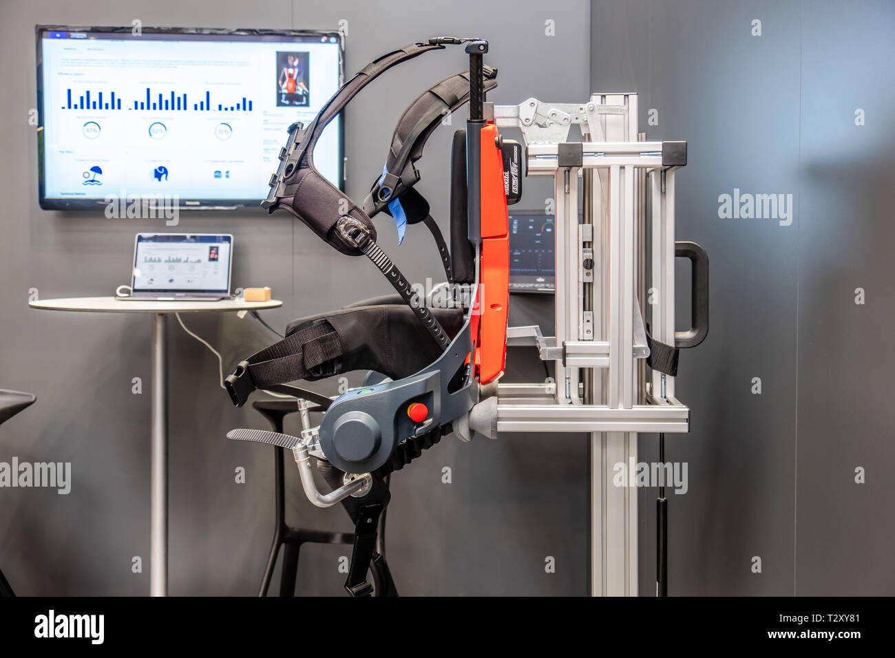 HANNOVER / GERMANY - APRIL 02 2019 : German Bionic presents first robot exoskeleton for the Industrial IoT at the HANNOVER FAIR. - Stock Image