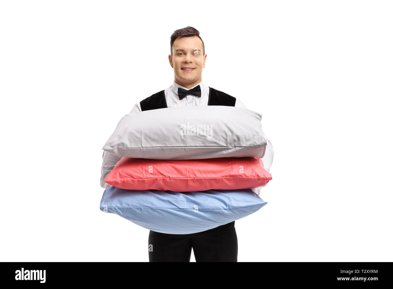Bellboy with pillows isolated on white background - Stock Image