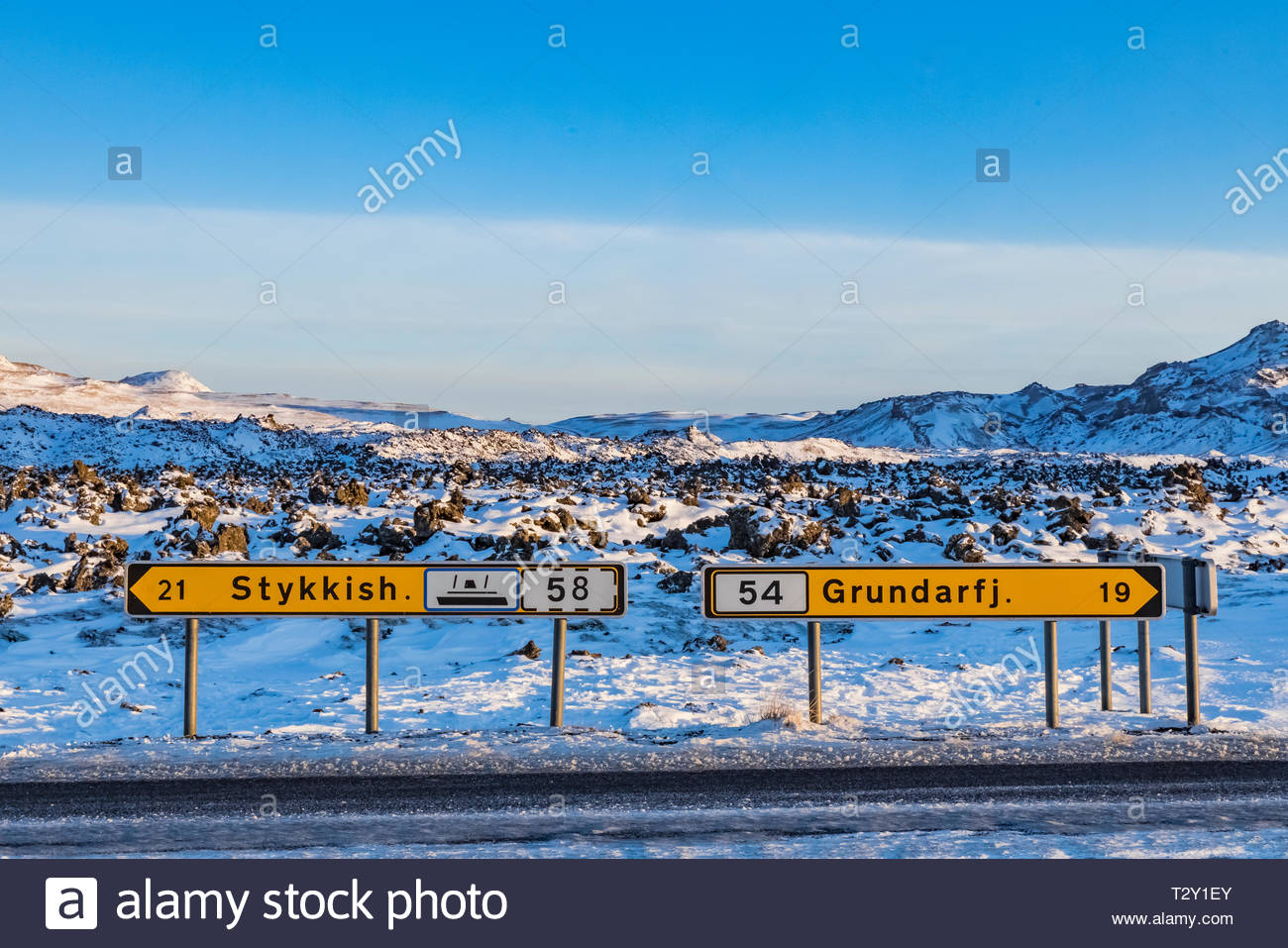 Highway signs in Berserkjahraun Lava Field at Bjarnarhofn on Snaefellsnes Peninsula of Iceland - Stock Image
