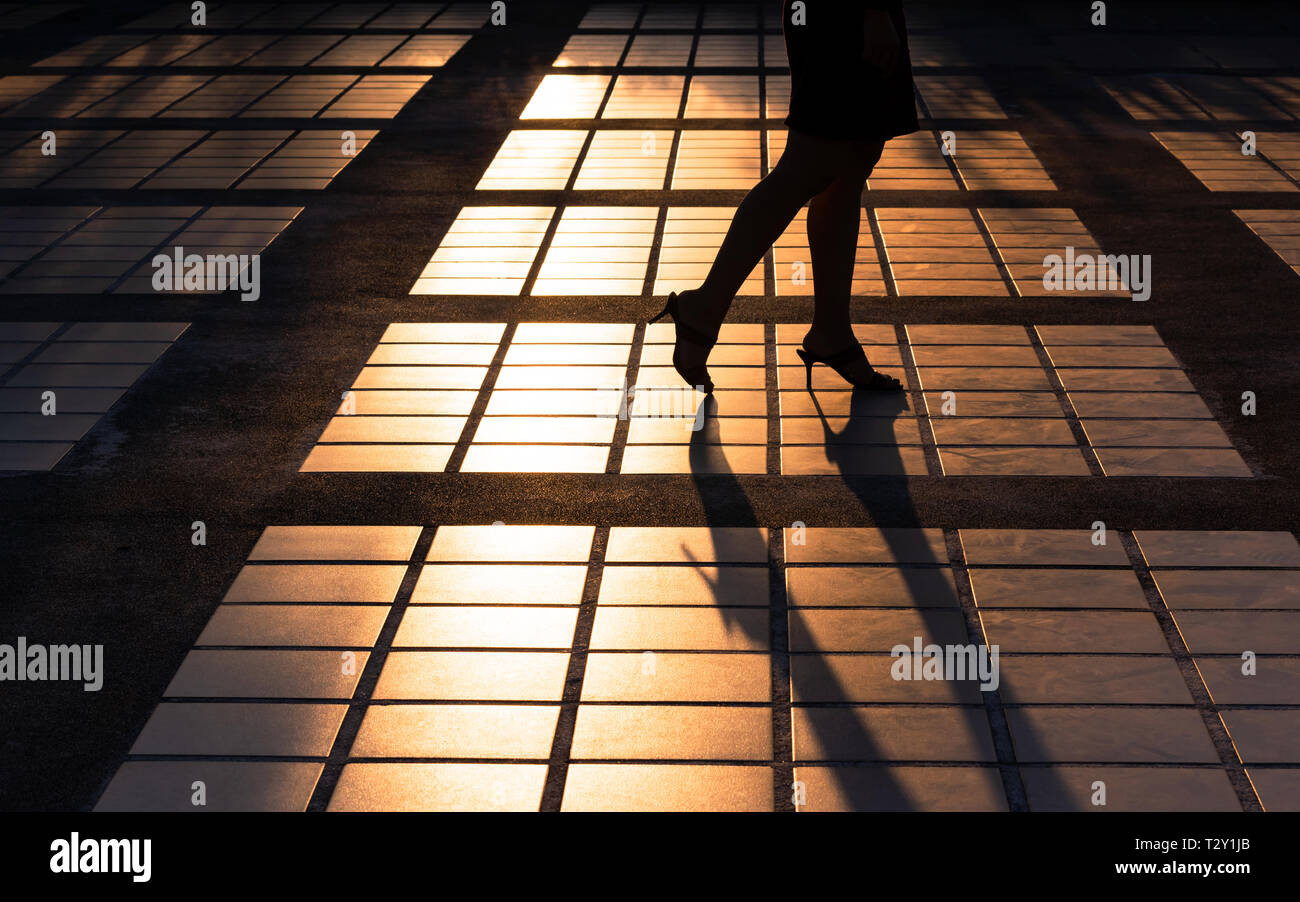 Silhouette of legs and high heels - Stock Image