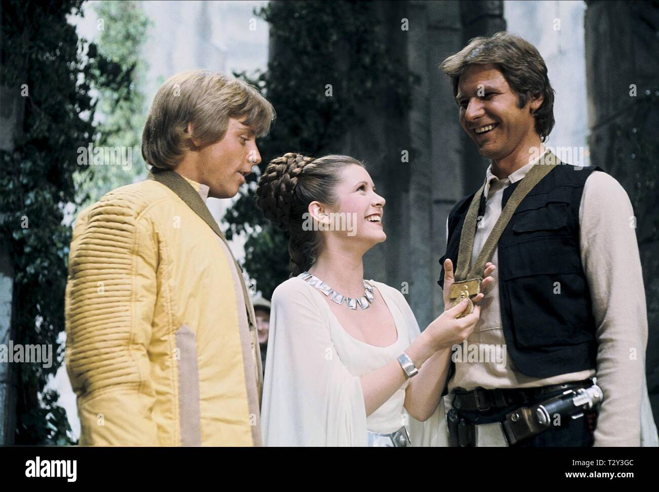 MARK HAMILL, CARRIE FISHER, HARRISON FORD, STAR WARS: EPISODE IV - A NEW HOPE, 1977 - Stock Image