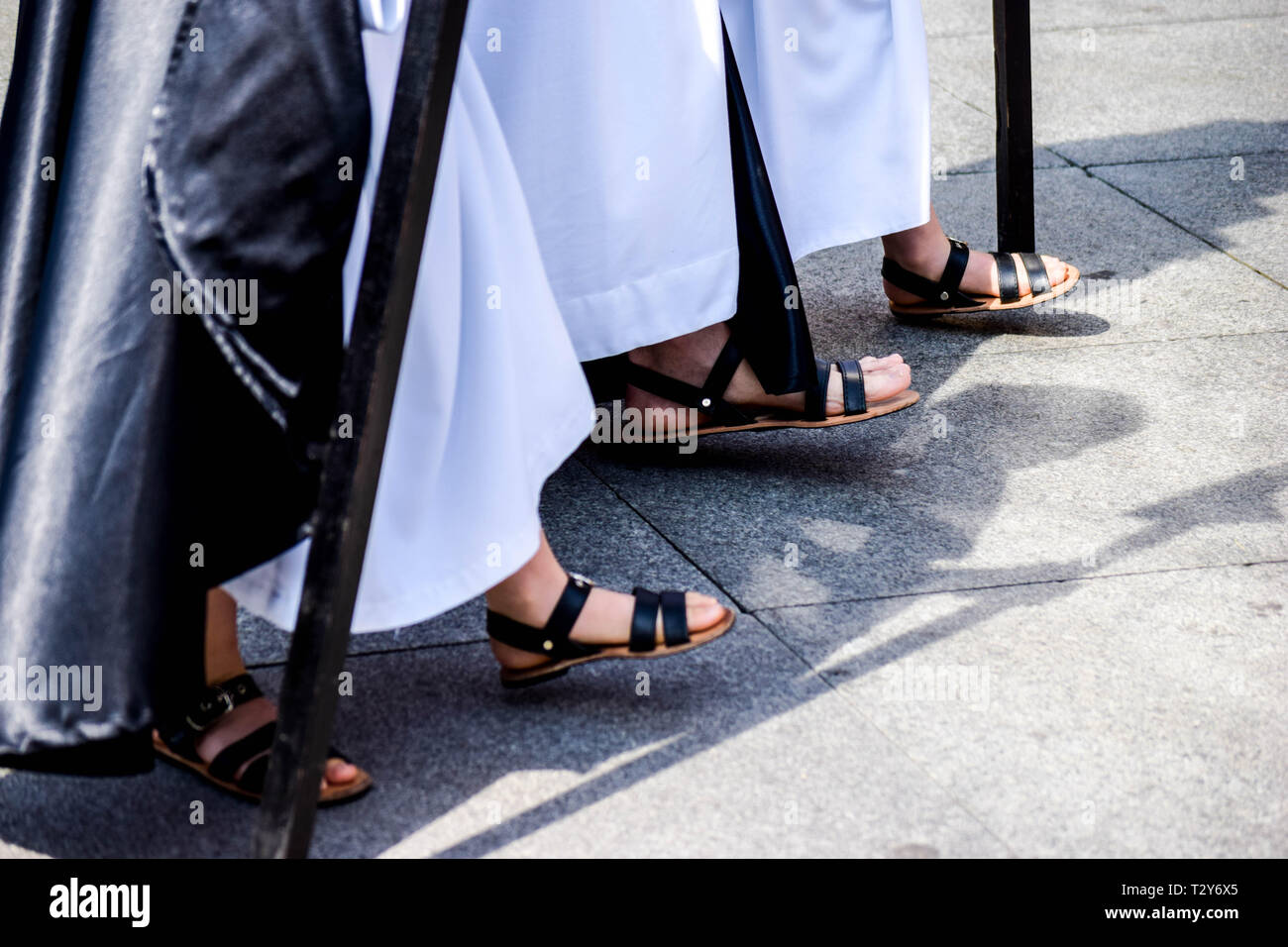 Penitents walking toguether on Holy Week in Spain - Stock Image